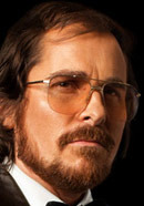 Christian Bale as Irving Rosenfeld