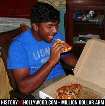 Dinesh Patel eating pizza